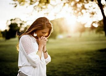 This image has an empty alt attribute; its file name is oip-1woman-praying.jpg