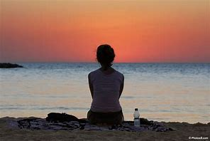 Image result for free pics woman sitting on beach